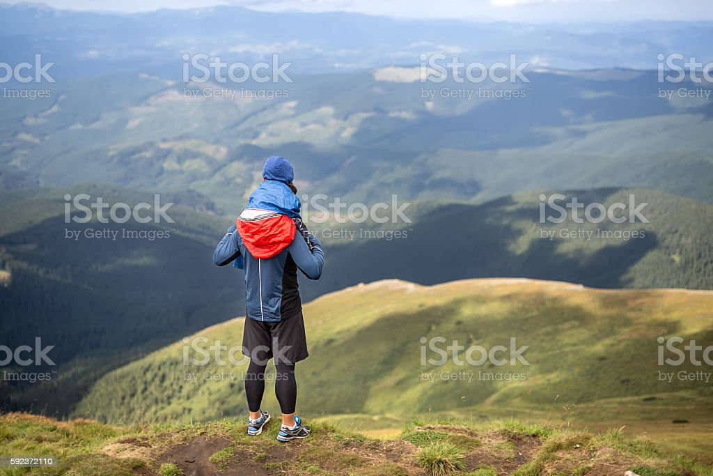 Son and father in mountains stock photo