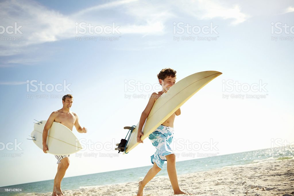 Son and father on the beach royalty-free stock photo