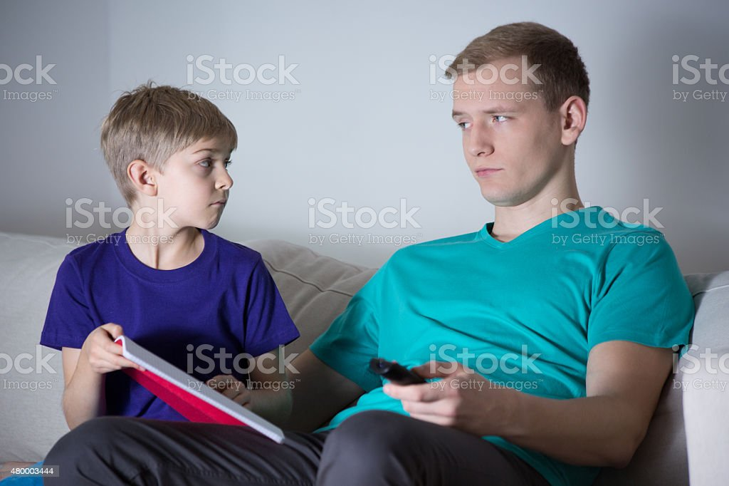 Son asks his father for help stock photo