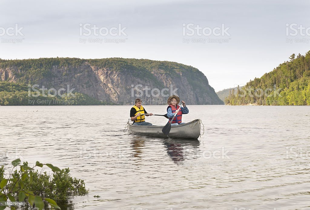 Son Canoeing with Mother royalty-free stock photo