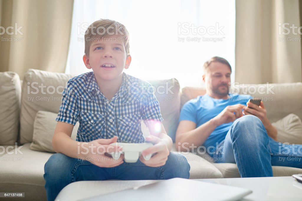 Son captured with video game stock photo