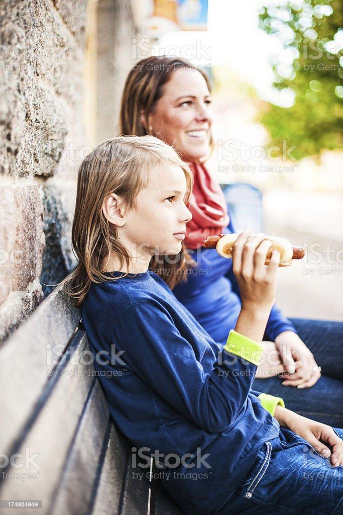 Son eating a hotdog stock photo