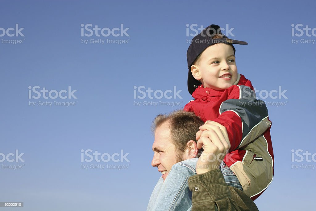 son on father shoulders royalty-free stock photo