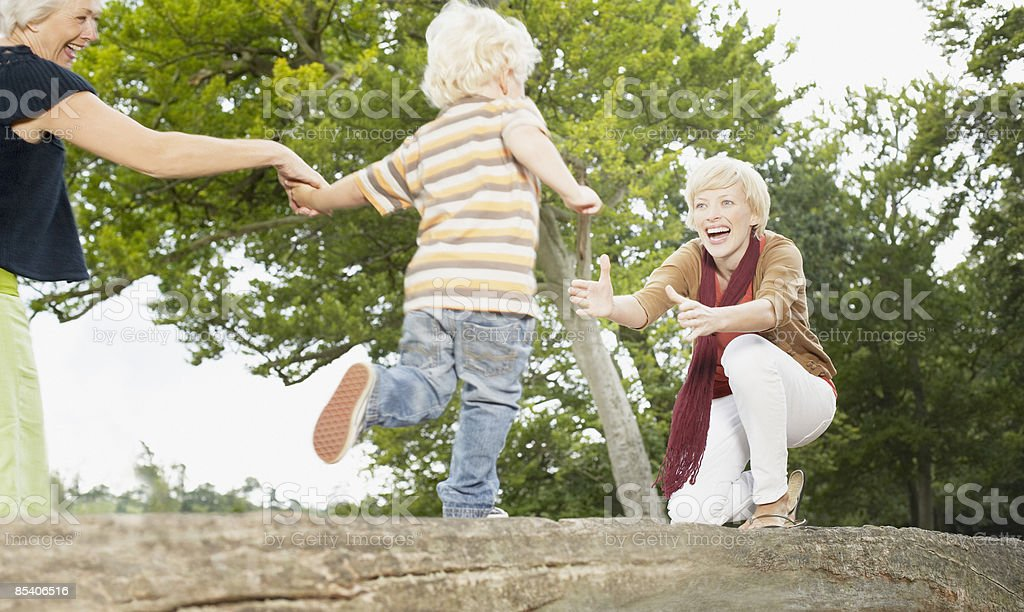 Son running to hug his mother royalty-free stock photo