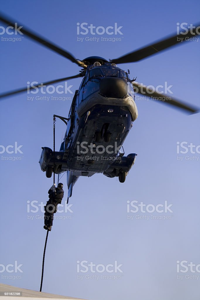 SWAT / Sondereinheiten Agent Descending on Rope from a Helicopter stock photo