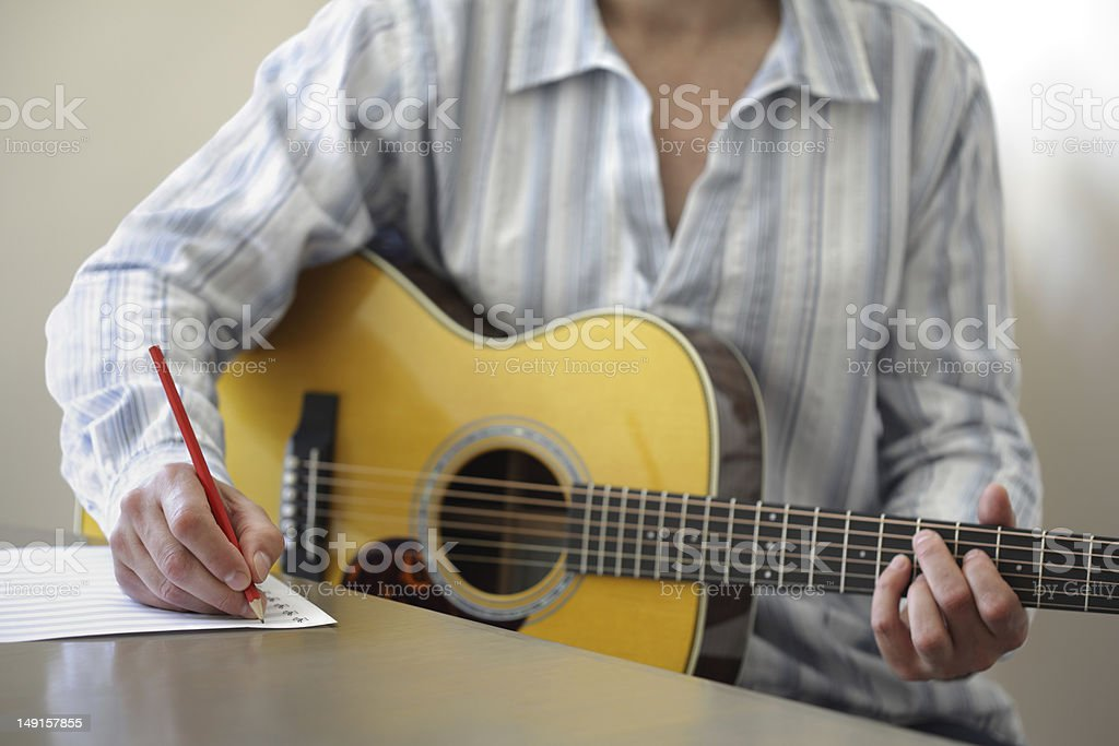 Song writing with acoustic guitar stock photo