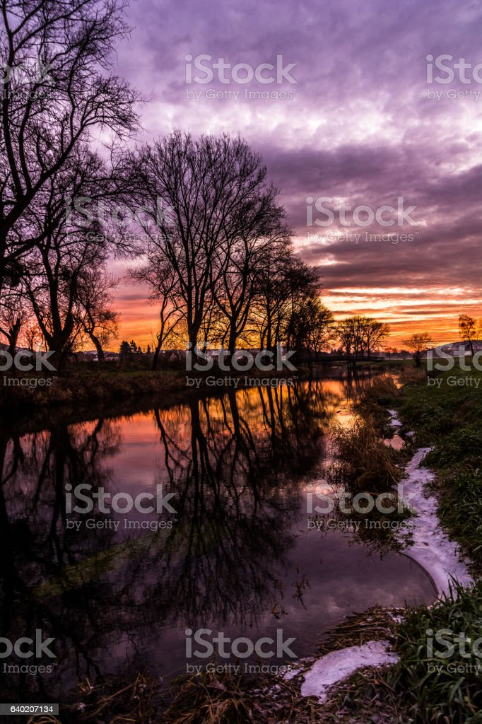 Sonnenaufgang an der Rhume stock photo