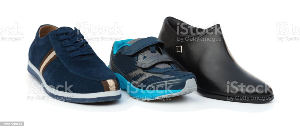 sons shoes surrounded by dad and moms on white background stock photo