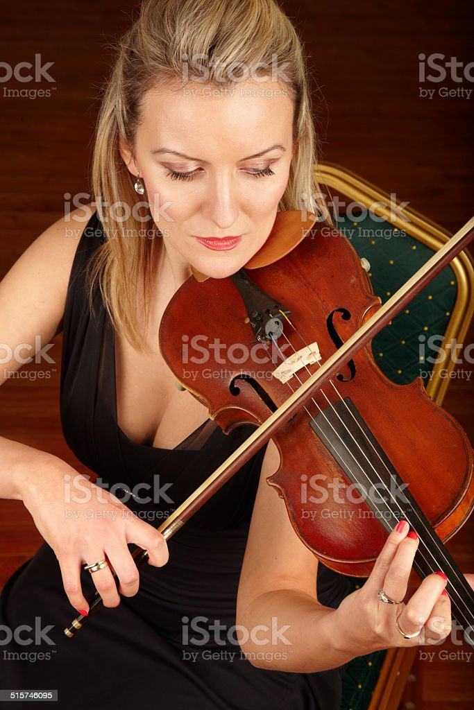 Soothed by the sound of her strings stock photo