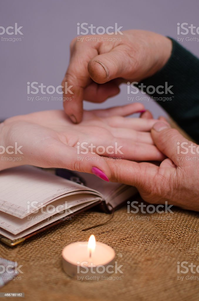 Soothsayer during session doing palmistry stock photo