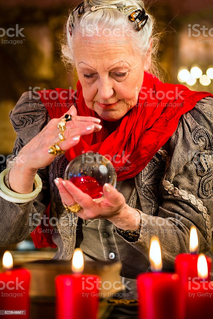 Soothsayer during session with crystal ball stock photo