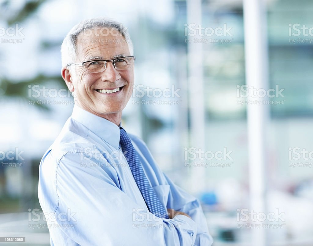 Sophisticated business man smiling stock photo