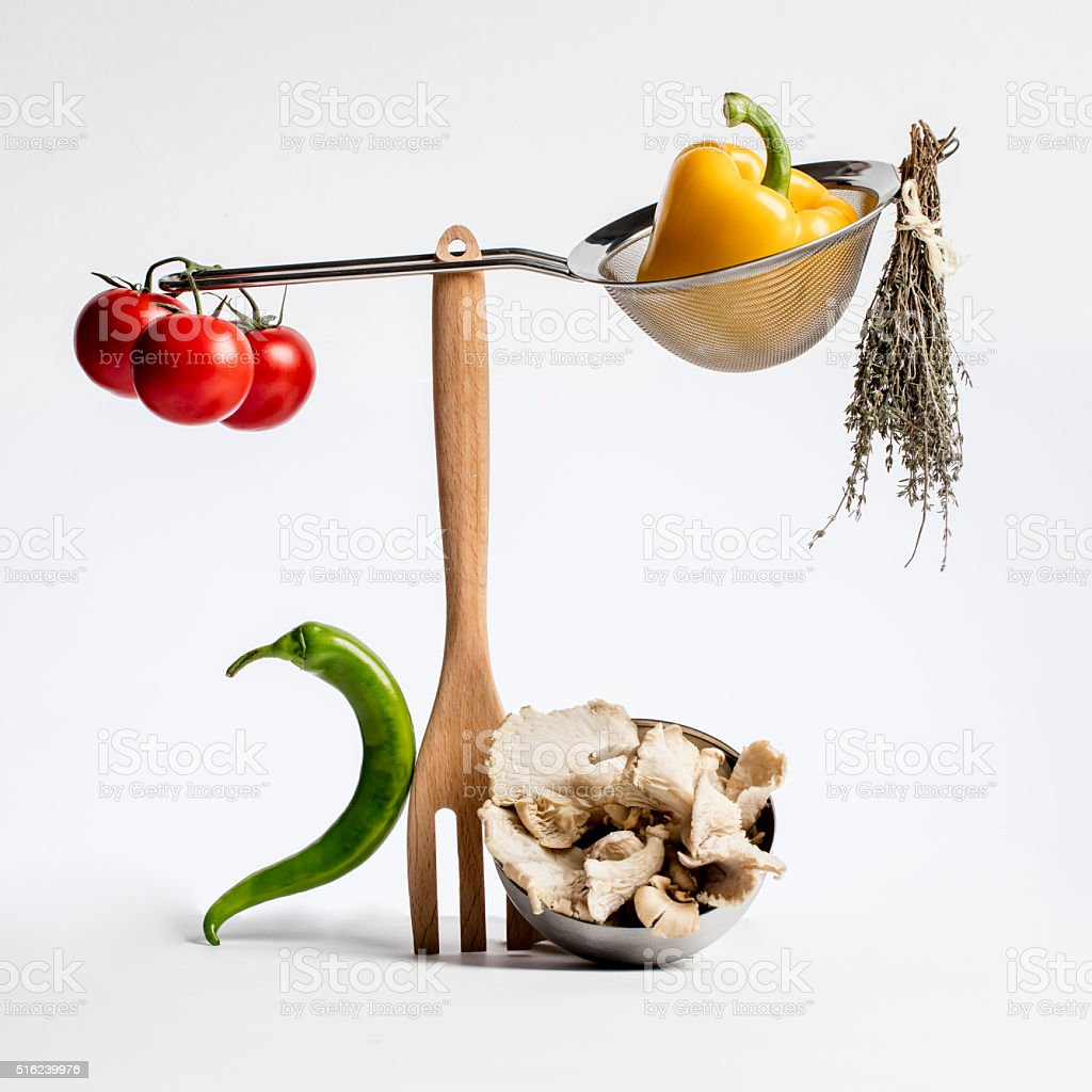 sophisticated gastronomy with gourmet food ingredients playing with cuisine utensils stock photo