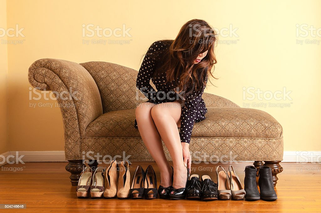 Sophisticated woman trying on shoes in store stock photo