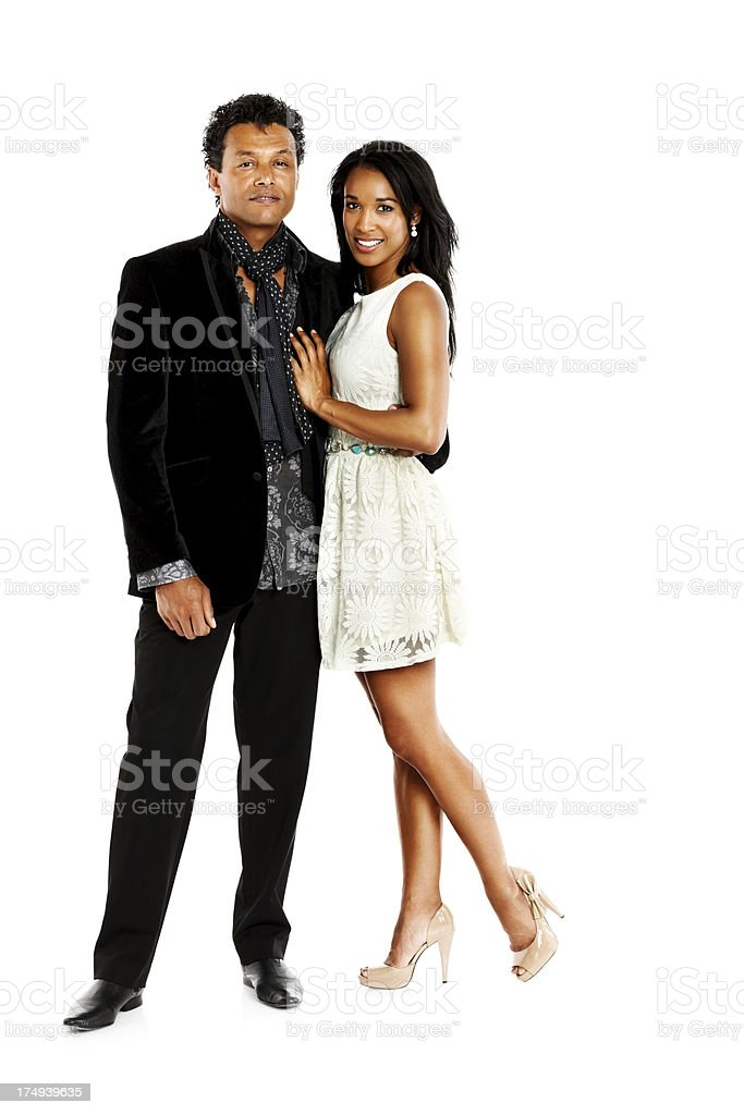 Sophisticated young couple standing on white royalty-free stock photo