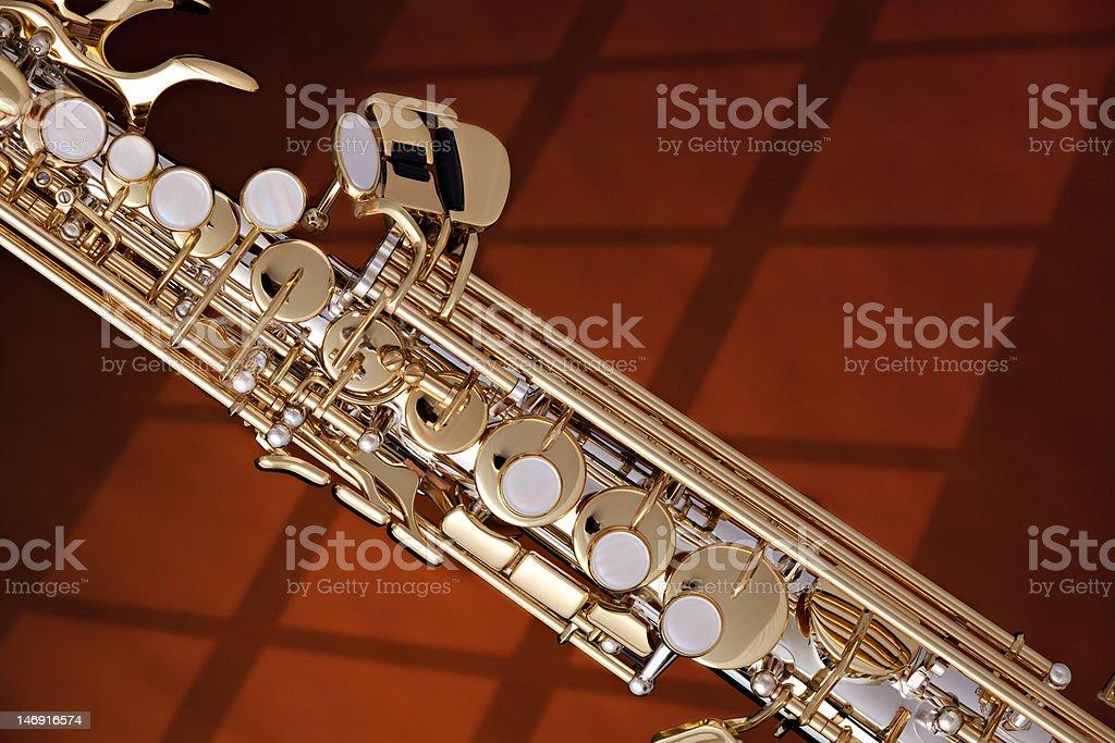 Soprano Saxophone Isolated against Gold stock photo