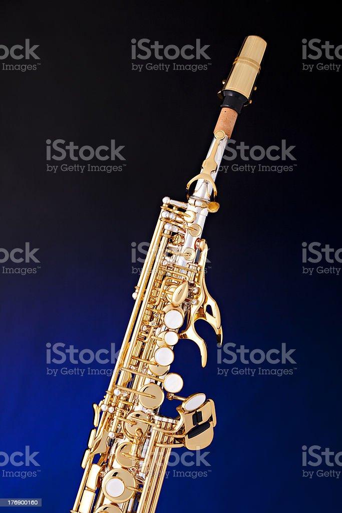 Soprano Saxophone Isolated On Blue stock photo