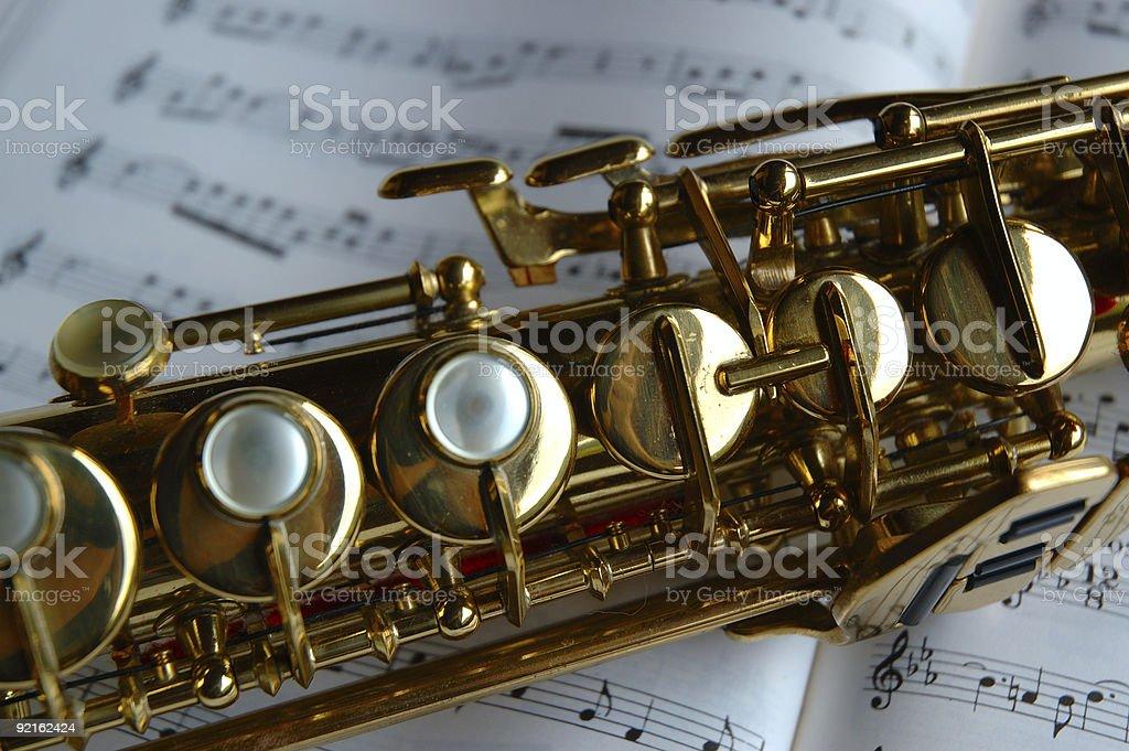 Soprano saxophone on music sheets stock photo