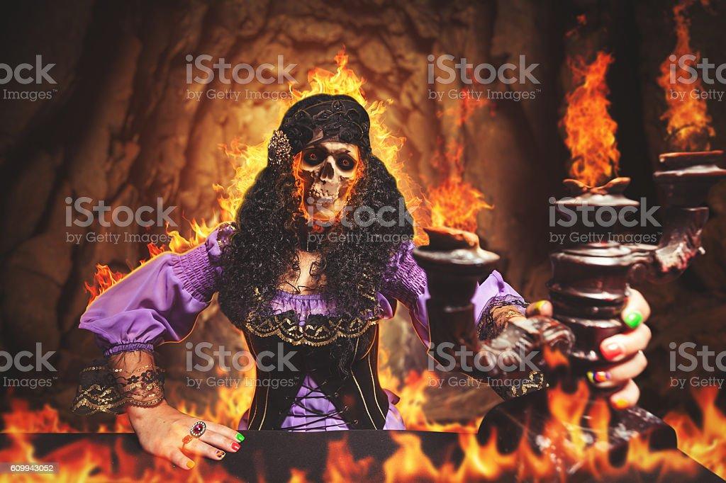Sorceress burning away stock photo