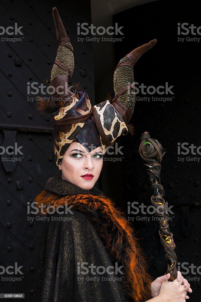 Sorceress with magic wand stock photo