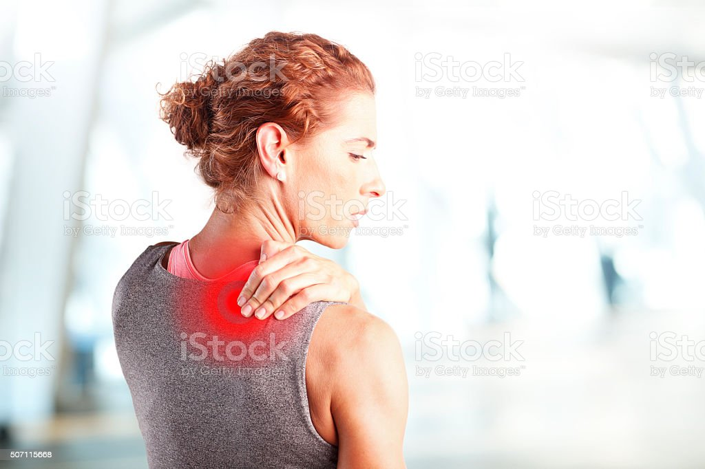 Sore after hard workout at fitness stock photo