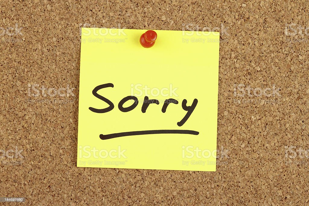 Sorry written on an Adhesive Note stock photo