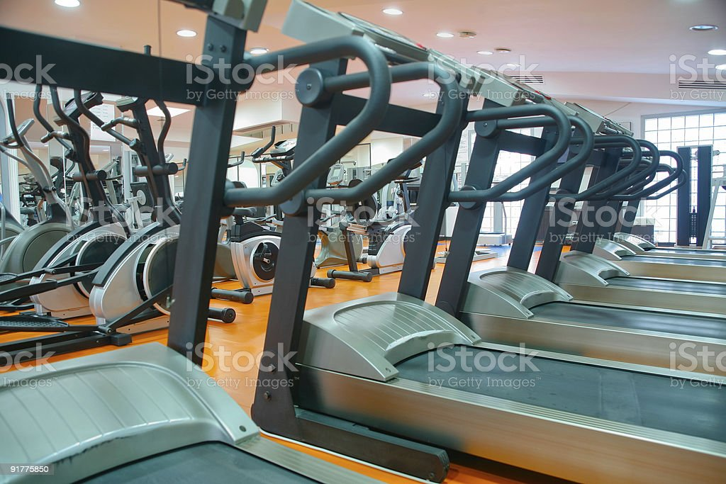 Sorted treadmills in empty gym royalty-free stock photo