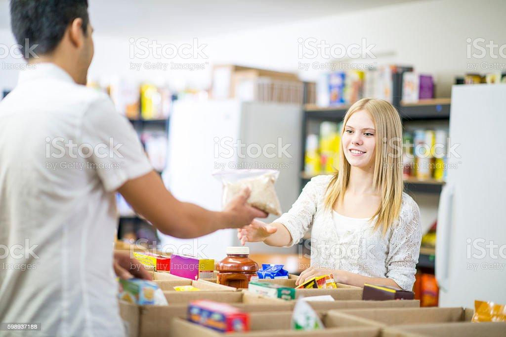 Sorting Food at a Food Bank stock photo
