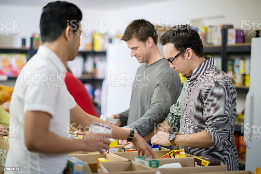 Sorting Food at the Homeless Shelter stock photo