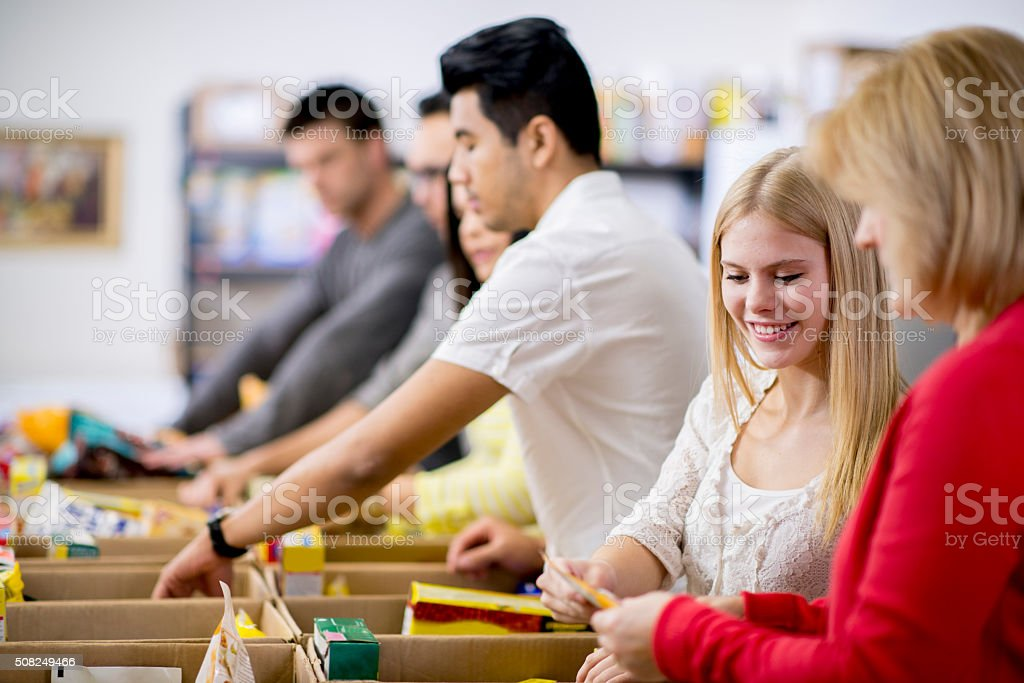 Sorting Food for a Shelter stock photo