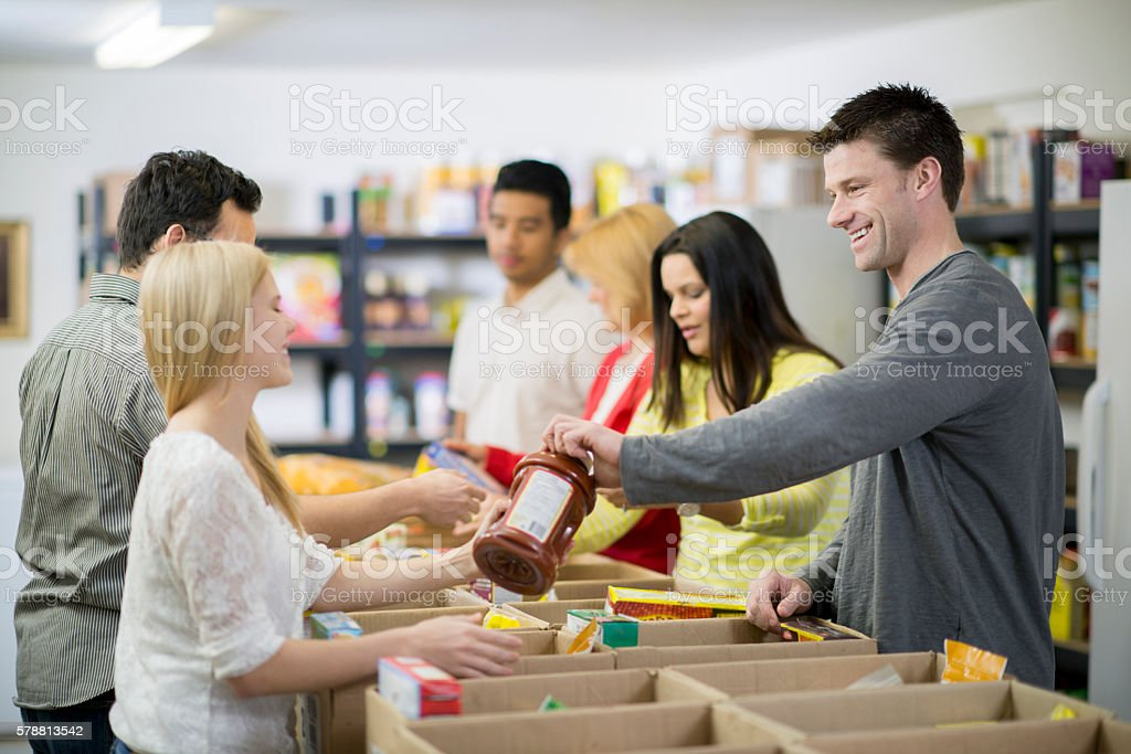 Sorting Food for Donations stock photo