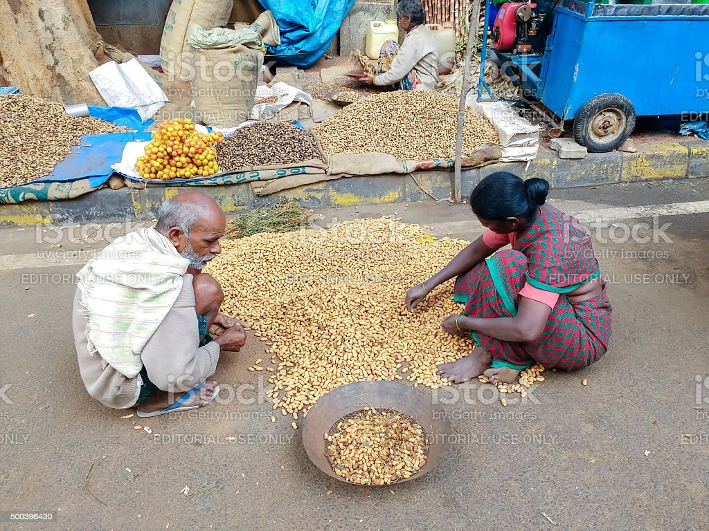 Sorting unshelled peanuts, Bangalore, India stock photo