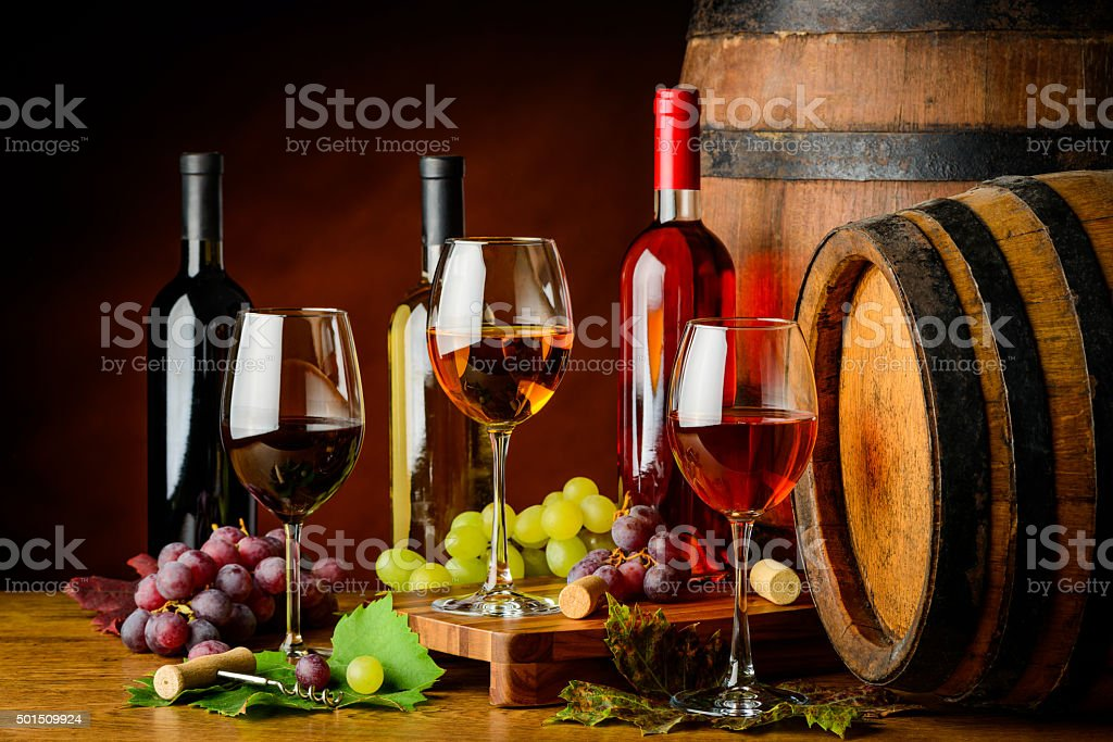 sorts of wine in bottles and glasses stock photo
