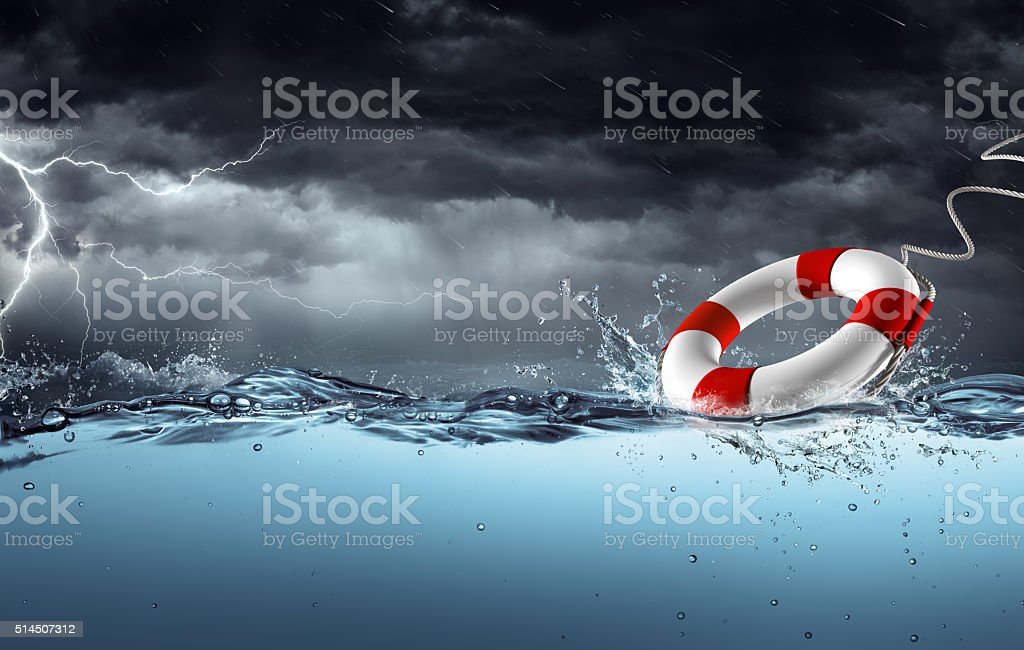 Sos - Lifebelt In Tempest For Help Concept stock photo