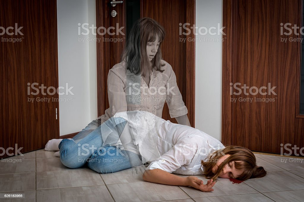 Soul leaves the body after the woman's death stock photo