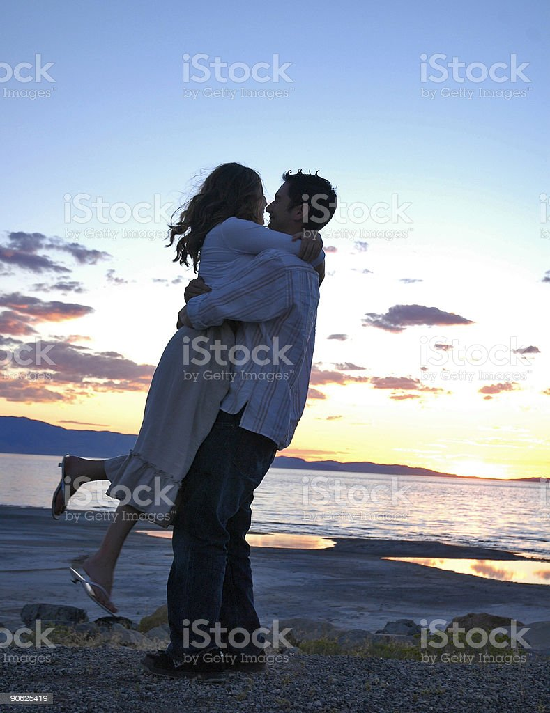 Soul Mates Embracing During Sunset royalty-free stock photo