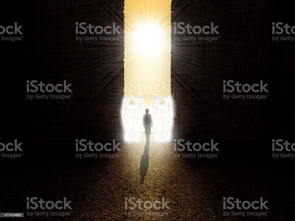 Soul standing at the entrance to paradise stock photo