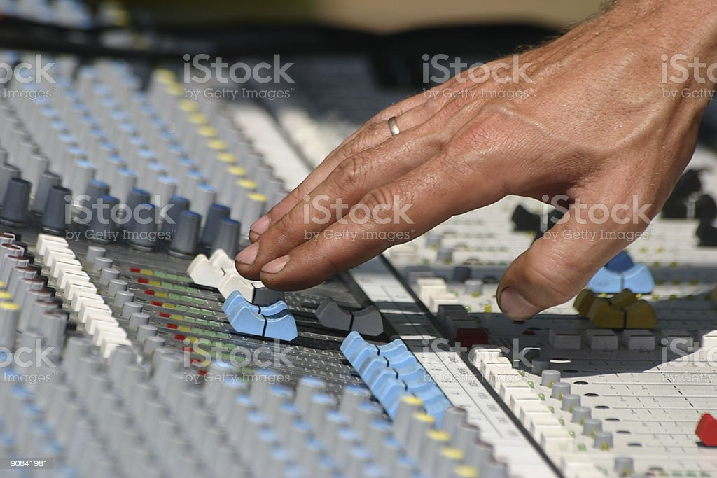 Sound engineer at mixing desk royalty-free stock photo