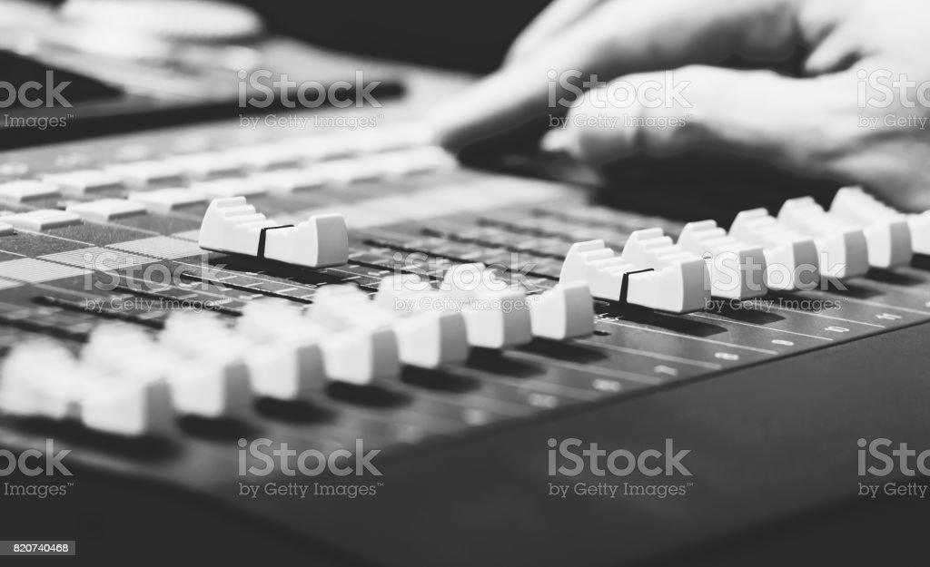 sound engineer hands on sound mixer stock photo