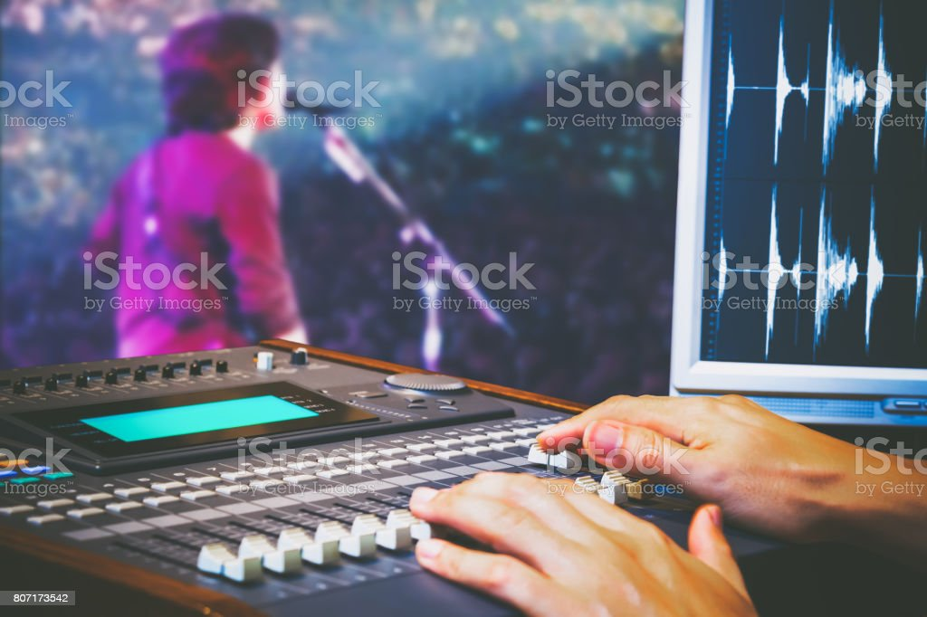 sound engineer hands working on digital sound mixer for live concert recording stock photo