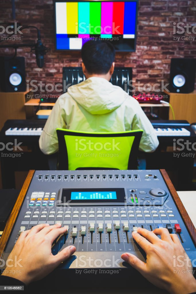 sound engineer & music producer working in digital editing studio, post production, broadcasting, recording concept stock photo