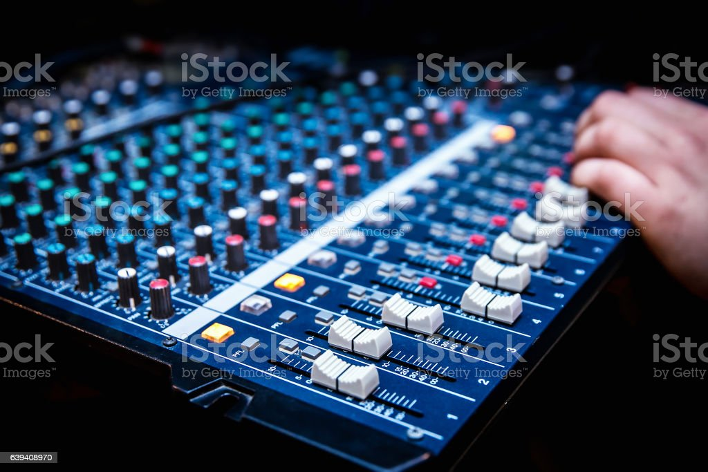 Sound manager is working on the audio mixer stock photo