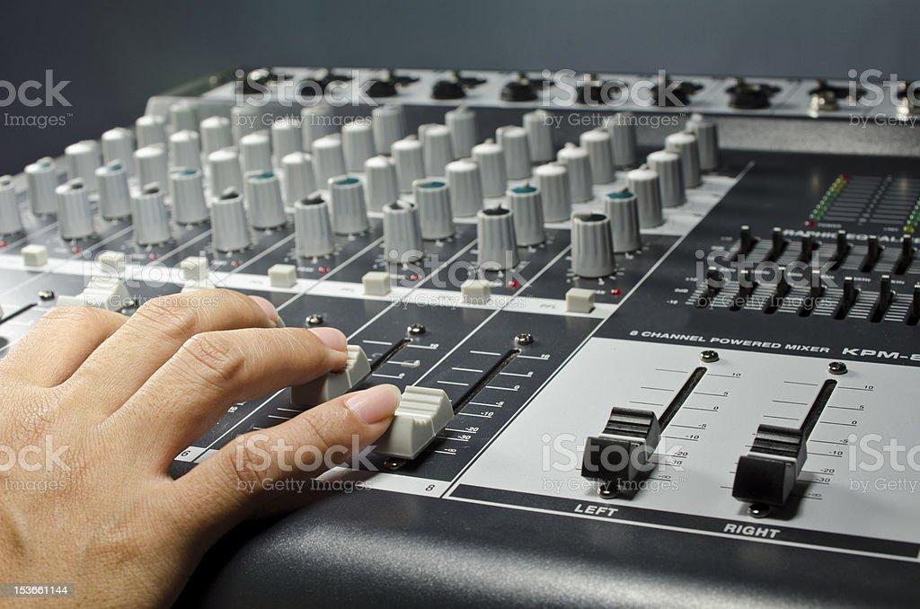 Sound mixer and DJ's hand royalty-free stock photo