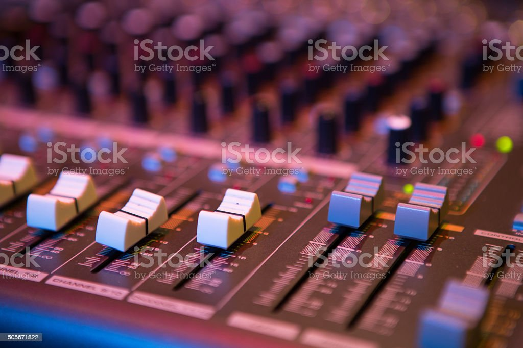 Sound mixer control panel, close-up audio controls stock photo