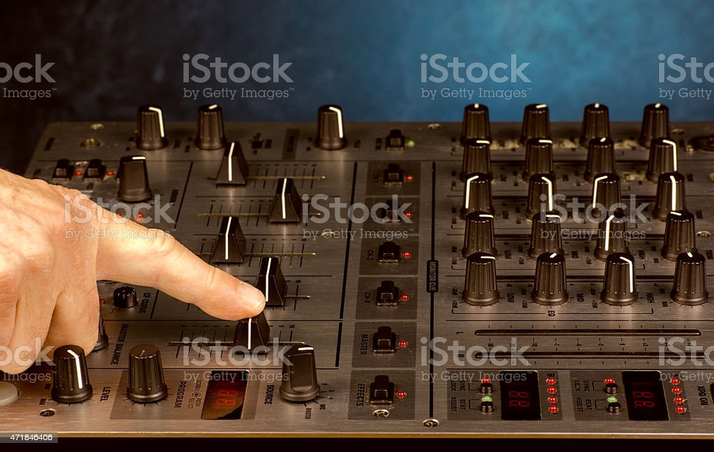 Sound Mixer finger pushing volume slider stock photo