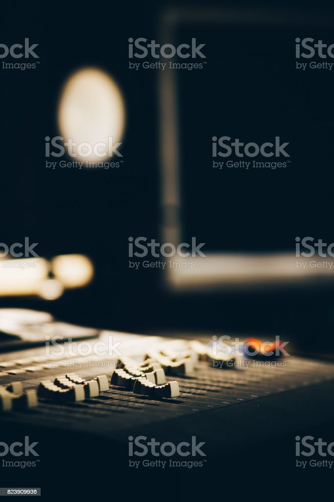 sound mixer in recording studio, shallow dept of field. focus on fader stock photo