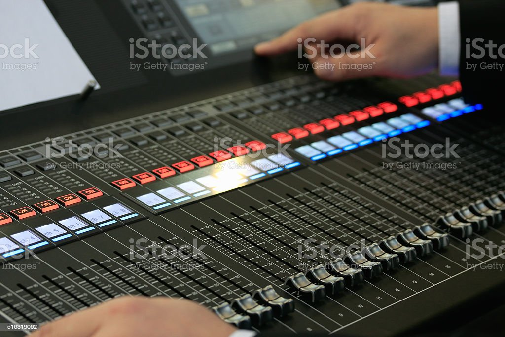 sound mixing board with male hands stock photo