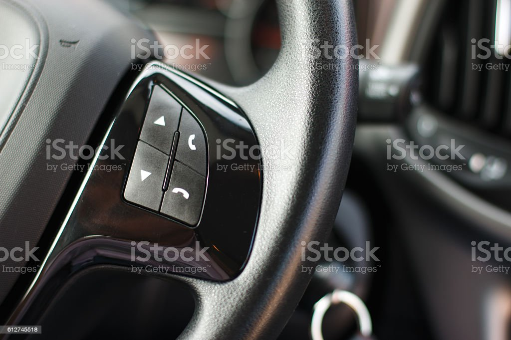 Sound phone function control button on the car steering wheel stock photo