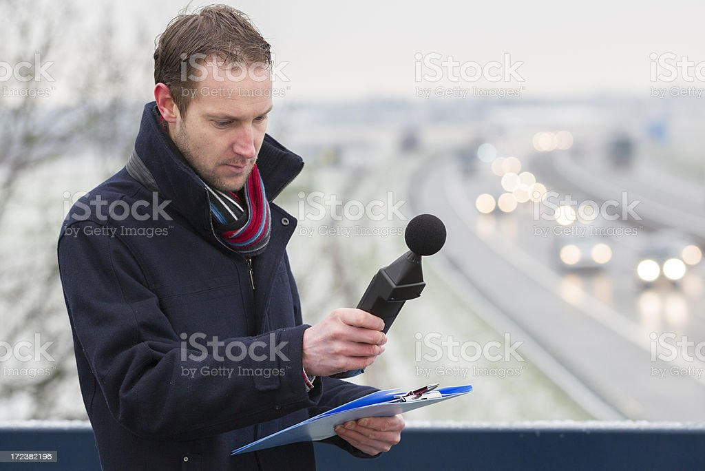 Sound pollution, man near highway stock photo