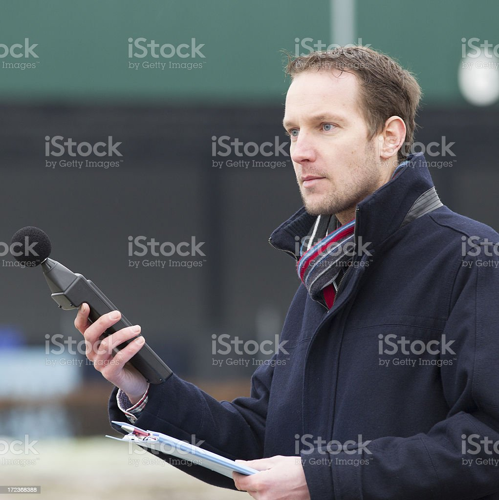 Sound pollution, man near industry royalty-free stock photo